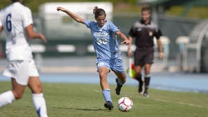 Tobin Heath was one of two Tar Heels representing Team USA in Tokyo. Heath is pictured preparing to pass the ball on Fetzer Field on September 7, 2008. Photo Courtesy of UNC Athletic Communications.