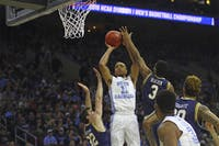 Senior Brice Johnson (11) shoots the ball during the Elite Eight game against Notre Dame Sunday. Johnson scored 25 points.