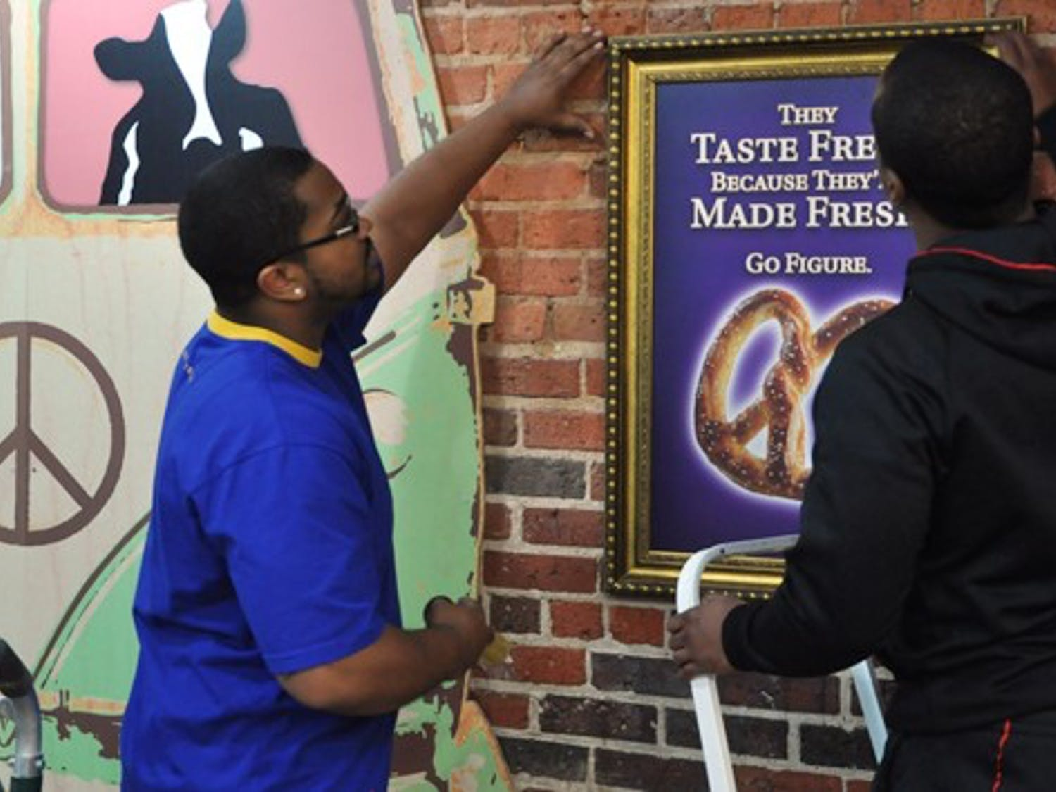 AUIYB - Owners Antonio McBroom (left) and Eric Taylor prepare for Ben and Jerry's Grand Re-Opening as well as Auntie Anne's addition Wednesday, January 11.