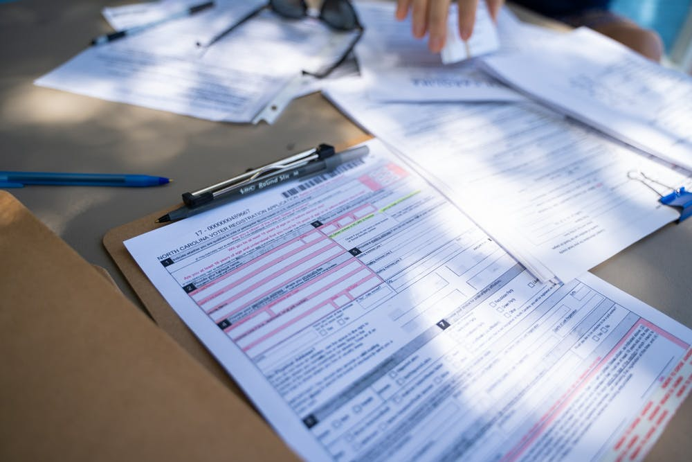 Voter registration forms at a table on Franklin Street on Saturday, Sept. 5, 2020.