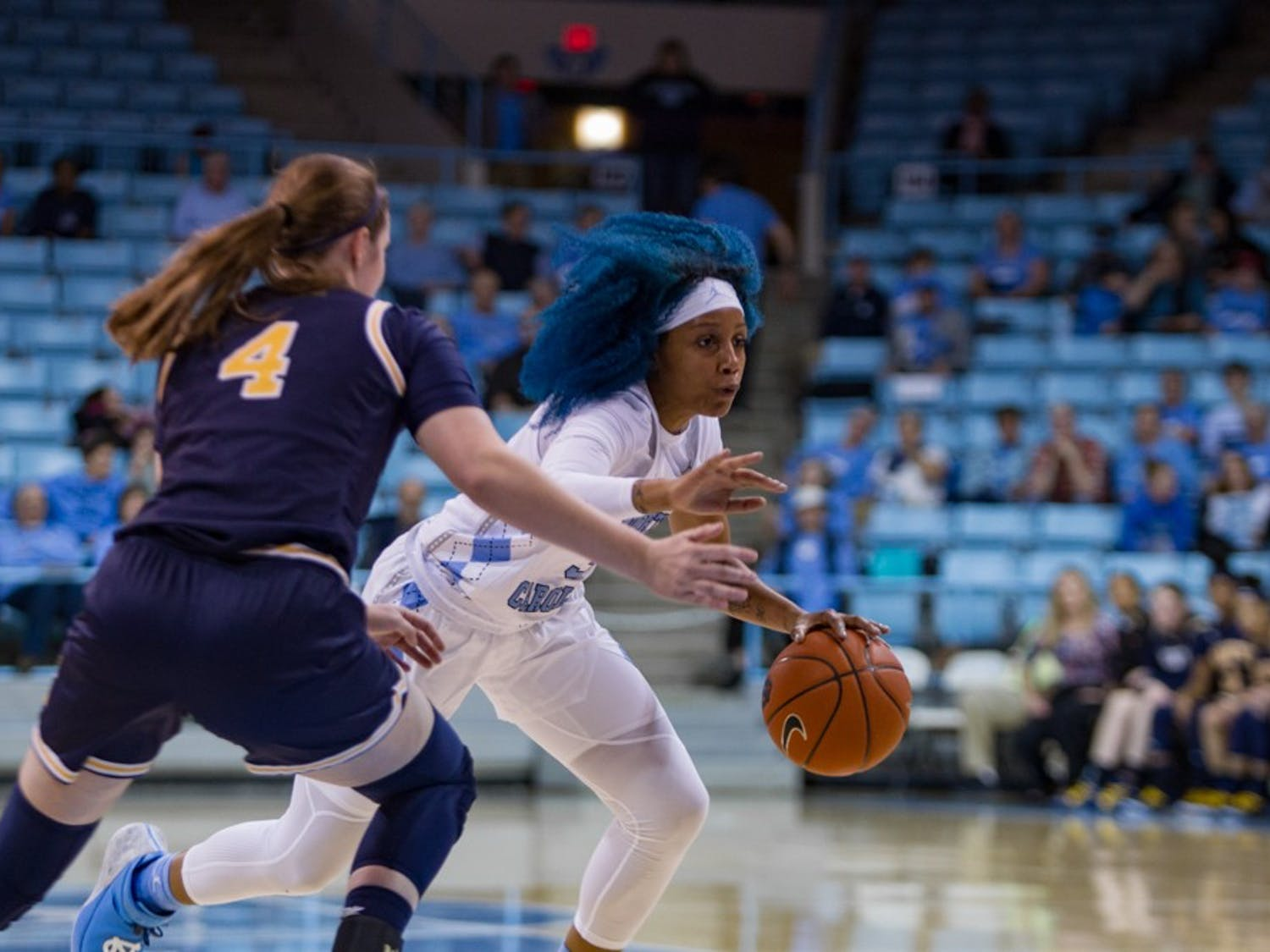 Senior guard Madinah Muhammad (3) dodges around Navy player in the women's basketball game against Navy in the Carmichael Arena on Monday, Nov. 11, 2019. UNC won 80-40.