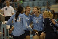 Beth Nordhorn (3) and Holly Carlton (6) celebrate with their teammates after a victory over Duke on Oct. 6.