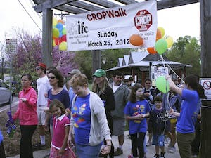 Participants kick off the IFC Crop Walk through Carrboro and Chapel Hill.