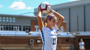 UNC senior defender Emily Fox (11) inbounds a ball. The Tar Heels beat the Virginia Tech Hokies 1-0 on Dorrance Field Sept. 20, 2020.