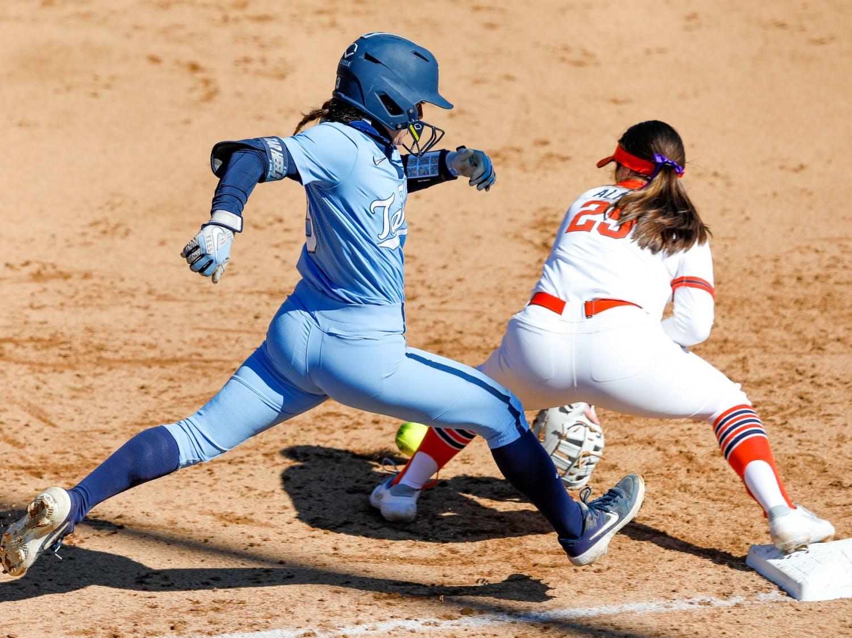 UNC freshman second baseman Kayla Baptista (3) runs to first base in Anderson Softball Stadium in Chapel Hill, NC on Feb. 20, 2021. The Syracuse Orange beat the Tar Heels 3-2.
