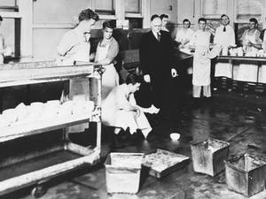 In 1931, UNC students washed dishes in the school dining halls for 25 cents per hour during the Great Depression to help pay for tuition. Photo courtesy of The North Carolina Collection, University of North Carolina library at Chapel Hill.