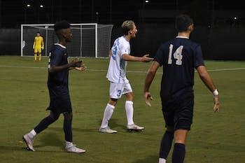 UNC midfielder Milo Garvanian (32) argues with defender Jose Luis Sena Arbona (14) during UNC's 2-1 win on Sept. 8 against Pittsburgh at Koskinen Stadium.