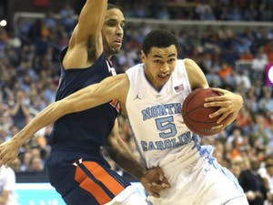 UNC basketball player Marcus Paige (5) moves past Virginia's Malcom Brogdon (15) during the ACC tournament in Washington, DC.