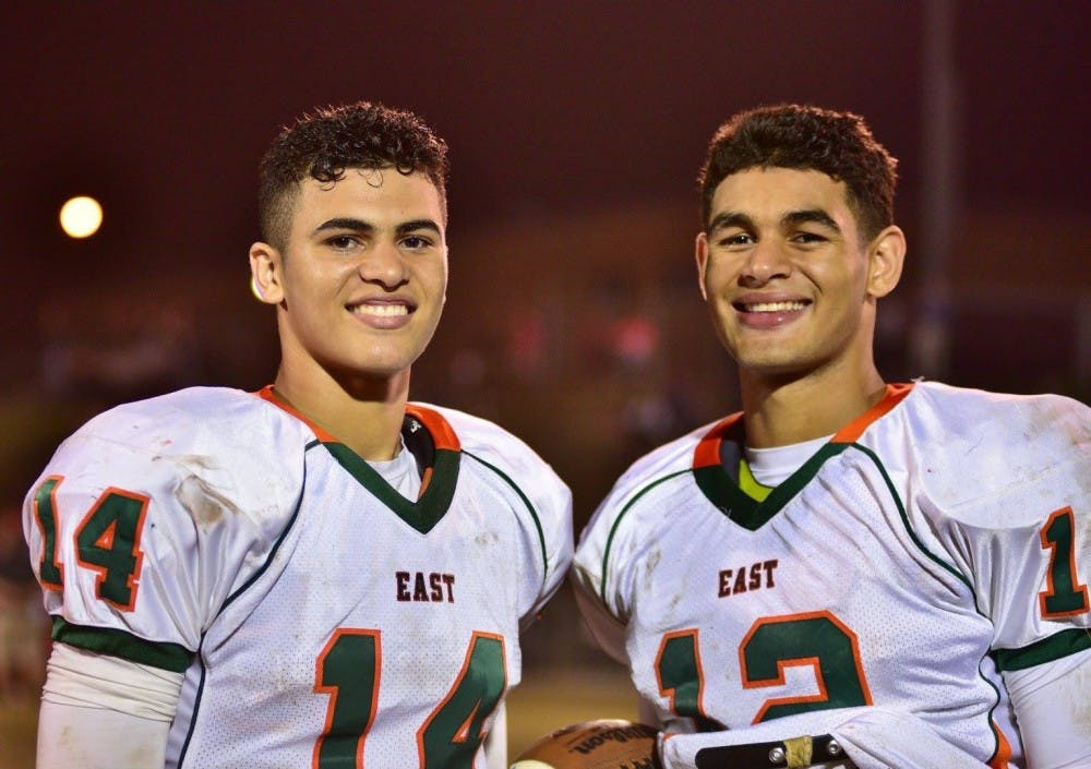 <p>North Carolina linebacker Chazz Surratt, right, and his brother Sage played three years of high school football together at East Lincoln in Denver, N.C. Chazz was the Mustangs' quarterback, and Sage was their top receiver. Photo courtesy of Brandi Surratt.</p>