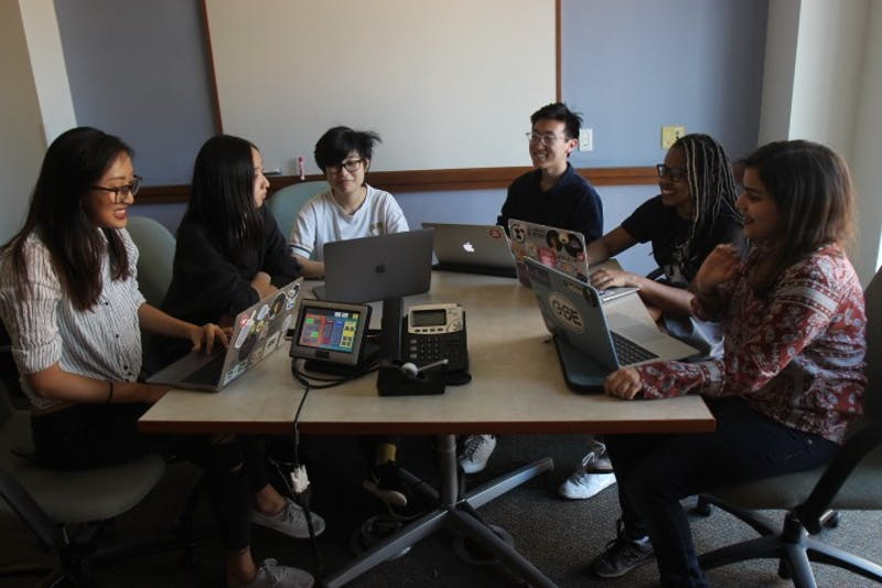 The executive team of Pearl Hacks, a female and non-binary hackathon, meets to work out details for their upcoming event in Sitterson Hall on Tuesday, Feb. 5, 2019. From left to right: sophomore Hannah Cao, junior Yujie Tao, senior Rachel Yuan, junior Jason Yu, sophomore Tylar Watson, and senior Misbah Ahmad.