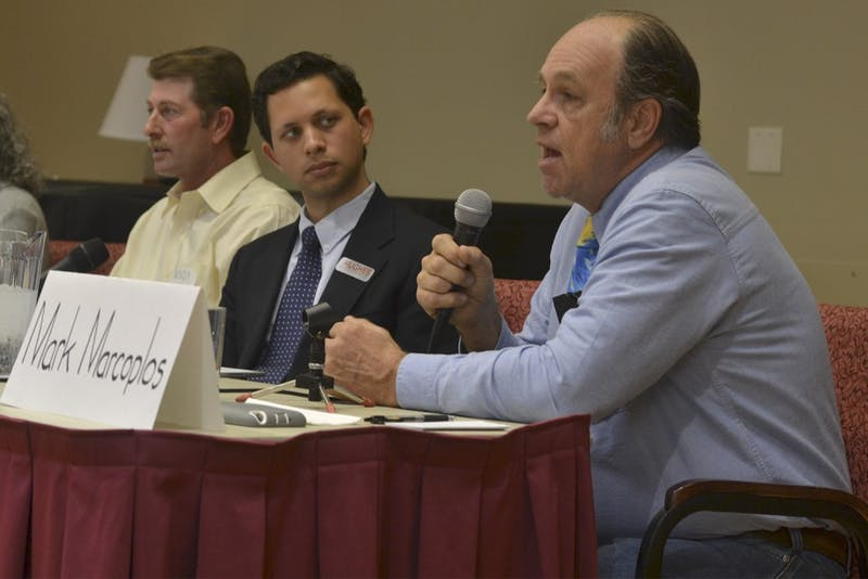Marc Marcoplos responds to a question posed by a member of the audience. Candidates for the Orange County Board of Commissioners spoke at a forum on Tuesday afternoon, March 1.