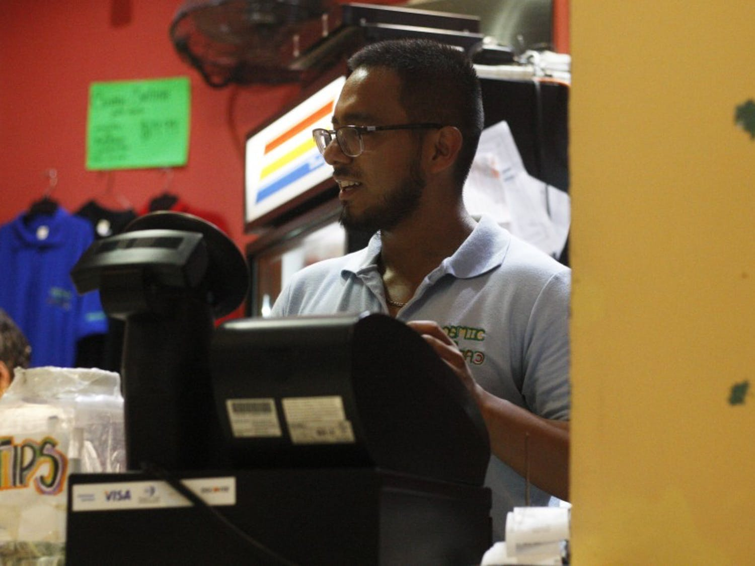 Yeshua Sanchez, a manager at Cosmic Cantina, takes an order in Cosmic on Thursday, July 11, 2019.