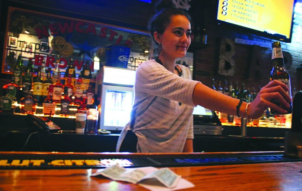 Servers, bartenders work with $2.13 minimum wage