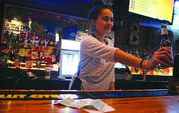 Alex Vasquez works on a tipped wage as a bartender at Four Corners. Recently non-tipped wages have gone up while tipped wages have reined the same.