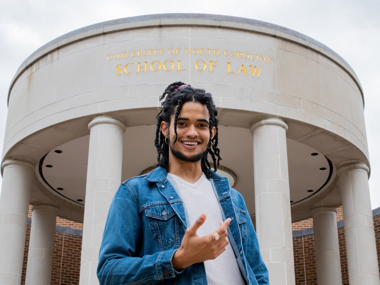 Zachary Boyce, a second-year UNC law student and candidate for Chapel Hill mayor, poses for a portrait in front of the Law School.