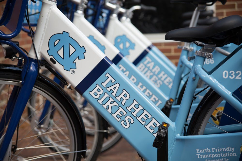 "<p>The ""Tar Heels Bikes"" bike share program was launched by Chancellor Folt and Associate Vice Chancellor of Campus Enterprises Brad Ives in front of Davis Library on Wednesday.</p>"