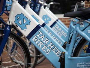 "The ""Tar Heels Bikes"" bike share program was launched by Chancellor Folt and Associate Vice Chancellor of Campus Enterprises Brad Ives in front of Davis Library on Wednesday."