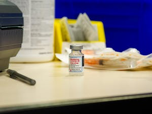 A dose of the Moderna COVID-19 vaccine sits on the desk of a volunteer on Thursday, Jan. 21, 2021 in the Friday Center in Chapel Hill.