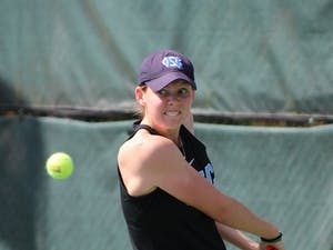 Elizabeth Scotty returns a volley during her victory over Florencia Urrutia from the University of Miami on March 6, 2021.