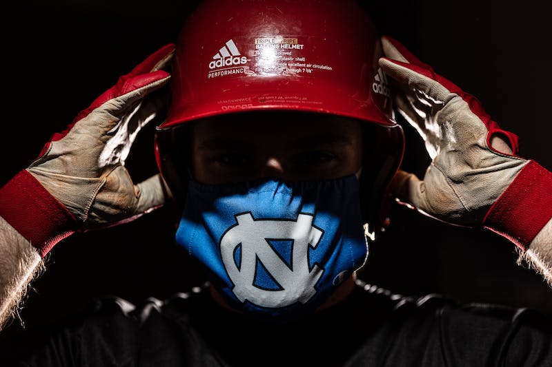 DTH Photo Illustration. With more and more collegiate sports seasons commencing during the ongoing COVID-19 pandemic, raising concerns about athlete safety and questions about liability.