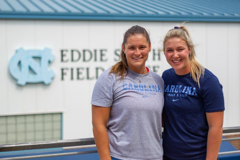 UNC senior thrower Jill Shippee (left) and UNC senior javelin thrower Madison Wiltrout (right) pose for a portrait on Aug. 18, 2020.