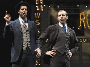 """Gideon Chickos (left) and Ethan Fox rehearse for the play """"Guys & Dolls,"""" Tuesday evening."""