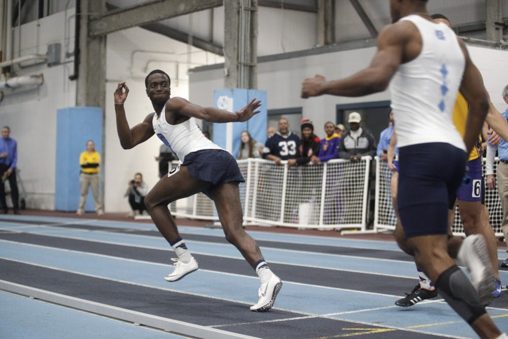 <p>Cameron Douglas, junior sprinter for UNC, reaches for the baton as he starts his sprint during the Men 4x400 Relay in the Dick Taylor Carolina Cup at Eddie Smith Field House on Saturday, Jan. 13, 2019. The Tar Heels won the relay with a time of 3:16.88.&nbsp;</p>