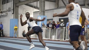 Cameron Douglas, junior sprinter for UNC, reaches for the baton as he starts his sprint during the Men 4x400 Relay in the Dick Taylor Carolina Cup at Eddie Smith Field House on Saturday, Jan. 13, 2019. The Tar Heels won the relay with a time of 3:16.88.
