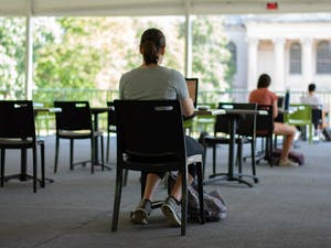 A student works at the newly implemented pavilion in Polk Place on Sunday, Sep. 6, 2020. Due to the COVID-19 pandemic, students are taking advantage of different study spaces around campus.