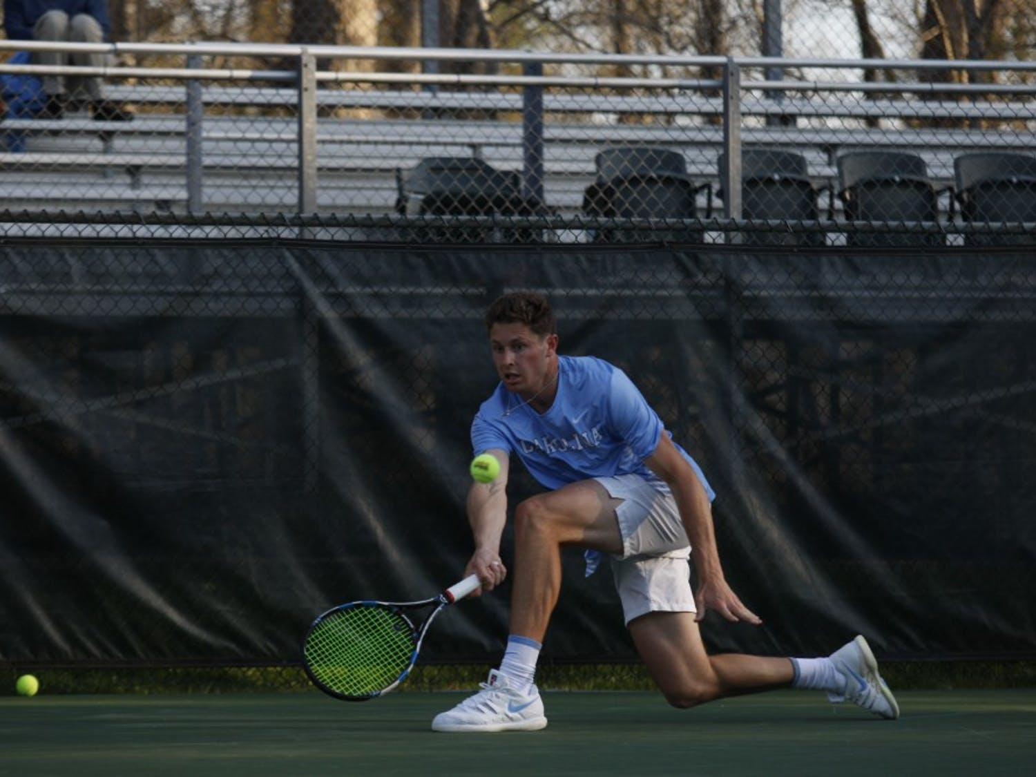"UNC men's tennis senior Blaine ""Bo"" Boyden prepares to return the ball during a singles match against NC State on Wednesday April 3, 2019. UNC beat NC State 4-0."