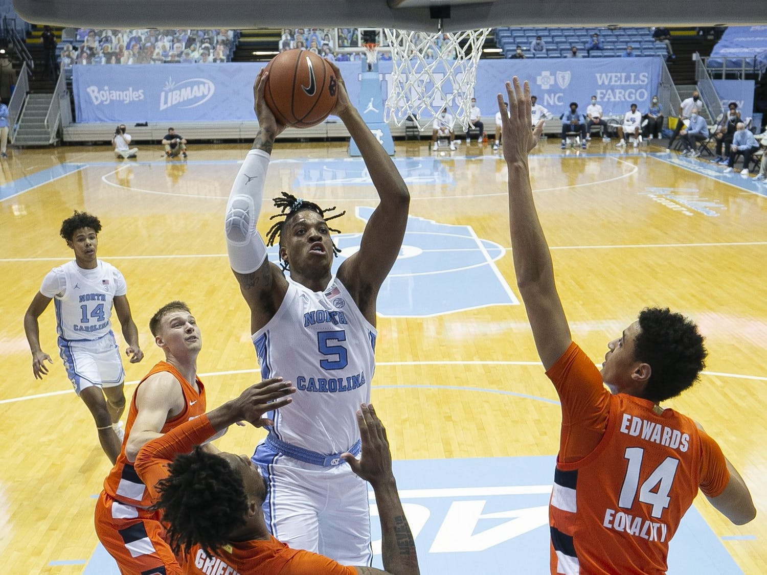 North Carolina's Armando Bacot (5) drives to the basket against Syracuse's Alan Griffin (0) and Jesse Edwards (14) in the first half on Tuesday, January 12, 2021 at the Smith Center in Chapel Hill, NC. Photo courtesy of Robert Willett.