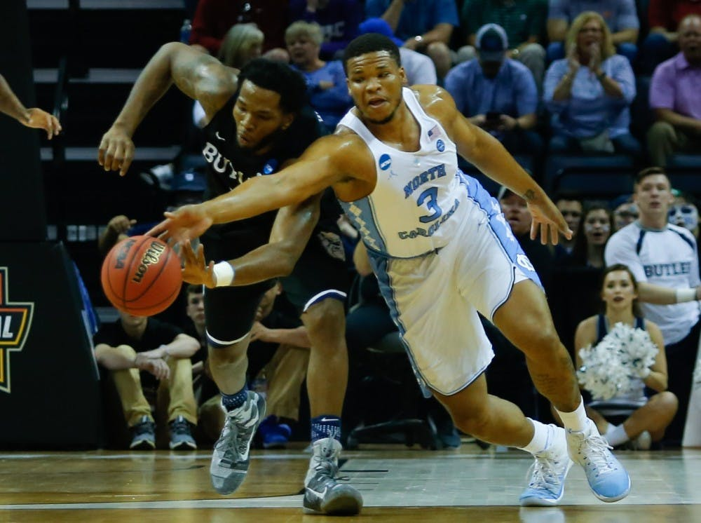 North Carolina forward Kennedy Meeks (3) lunges for a loose ball against Butler in the Sweet 16 matchup in Memphis on Friday.