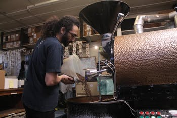 Carrboro Coffee Roaster's employee, David Ruiz, works on roasting coffee for Open Eye Cafe on the afternoon of Wednesday, Jan. 16, 2019. Carrboro Coffee Roasters is one of the many companies in Orange County that are an Orange County Certified Living Wage Employer.