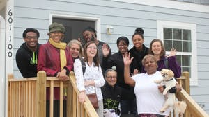 Marian Cheek Jackson Center staff and partners from Pee Wee Homes welcoming one of the center's newest Northside neighbors to the community. Photo courtesy of Hudson Vaughan.