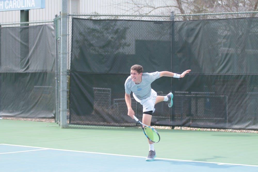 North Carolina men's tennis weathers the rain for a 6-1 win over Louisville