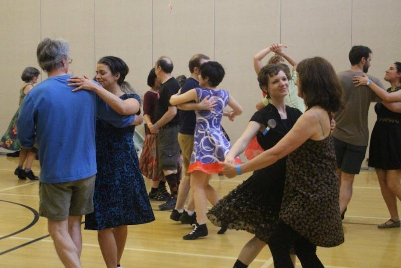 People participating in a contra dance event.  Photo by Kelly Wice