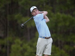 First year Peter Fountain completes a swing at the Chapman Center in Chapel Hill, NC on Wednesday, Jan. 15, 2020. Photo courtesy of Jeff Camarati for UNC Athletic Communications.