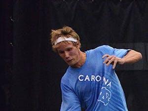 Esben Hess-Oleson, UNC's top-seeded singles player, maks a return on Saturday.
