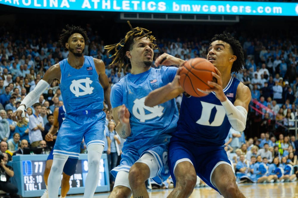 <p>Duke sophomore guard Tre Jones (3) and UNC first-year guard Cole Anthony (2) collide in the Smith Center on Saturday, Feb. 8. 2020. UNC lost to Duke in overtime 98-96.</p>