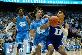 Duke sophomore guard Tre Jones (3) and UNC first-year guard Cole Anthony (2) collide in the Smith Center on Saturday, Feb. 8. 2020. UNC lost to Duke in overtime 98-96.