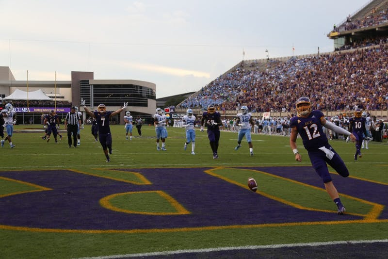 ECU freshman quarterback Holton Ahlers (12) scores a touchdown during the fourth quarter on Sept. 8th at Dowdy-Ficklen Stadium.