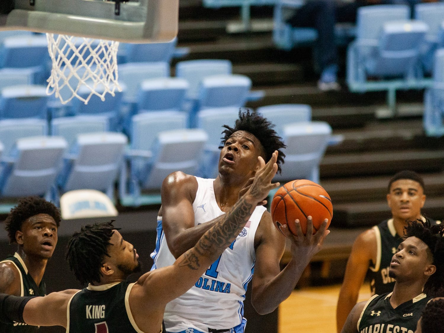 UNC first year Day'Ron Sharpe (11) forward drives toward the basket during a game against the College of Charleston in the Smith Center on Wednesday, Nov. 25, 2020. UNC won the game 79-60.
