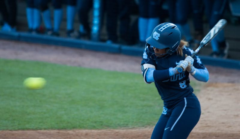 UNC senior outfielder Kiani Ramsey (8) bats during a double header against the FSU Seminoles at G. Anderson Softball Stadium on Monday, April 15, 2019. The Tar Heels beat the Seminoles in both games.