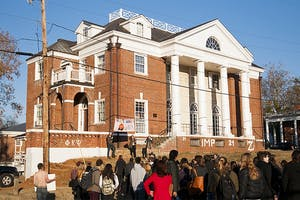 """University of Virginia students gather outside the Phi Kappa Psi house to protest the fraternity following the release of the explosive Rolling Stone article """"A Rape on Campus""""  in November. Courtesy of the Cavalier Daily/Sarah MacAdam."""