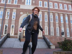 Jasper Christie, a first-year computer science major, rides their unicycle during a break between classes in front of Murphy Hall on Monday, Feb. 25, 2019.