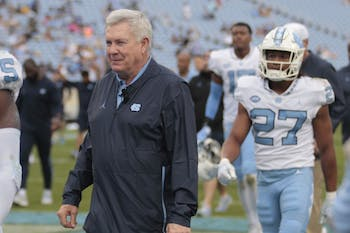 Head football coach Mack Brown returns to the locker room with his team during the spring football game in Kenan Memorial Stadium on Saturday April 13, 2019.