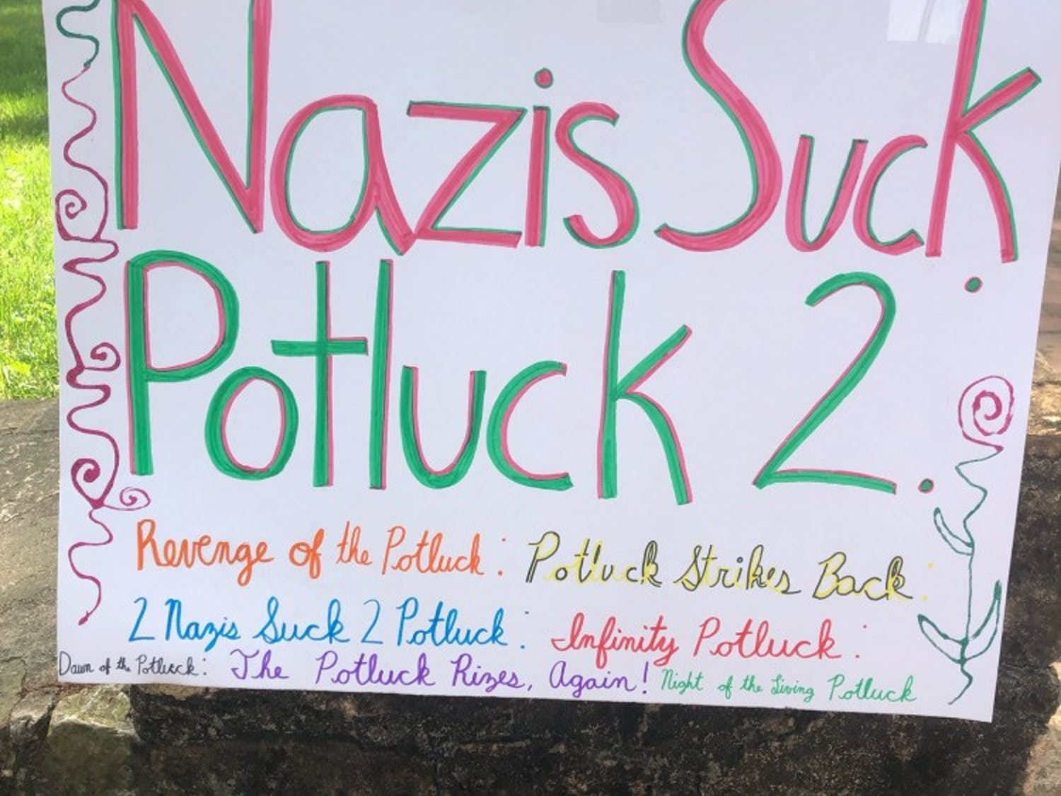 """Anti-Confederates organized the """"Nazis Suck Potluck 2"""" to oppose the pro-Confederate protest at the Peace and Justice Plaza."""