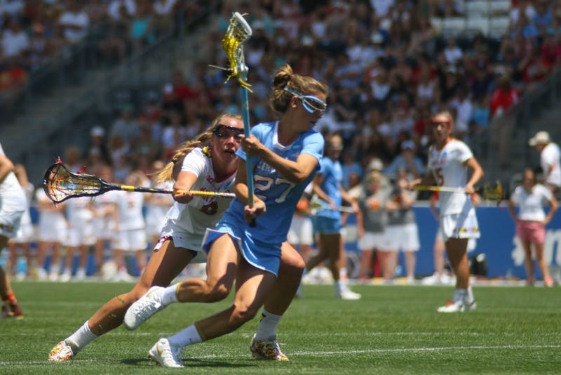 UNC attacker Aly Messinger (27) cradles the ball away from a Maryland defender. Messinger was named the NCAA Tournament's most outstanding player.The North Carolina women's lacrosse team defeated Maryland 13-7 to capture the NCAA championship on Sunday at Talen Energy Stadium in Chester, PA.