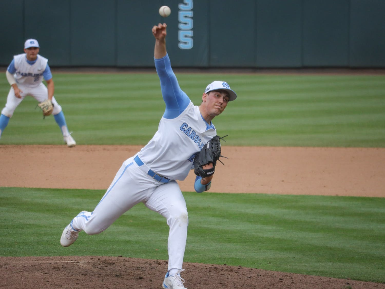 UNC senior pitcher Shawn Gage Gillian (15) pitches the ball during the Tar Heels' 1-6 loss against N.C. State on Saturday, March 27, 2021 in Boshamer Stadium in Chapel Hill, N.C.