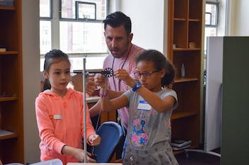 """Carolina's Department of Physics and Astronomy hosted third and fourth graders from three local elementary schools for a """"Science is Awesome"""" outreach event on May 15."""